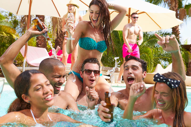Group Of Friends Having Party In Pool Drinking Champagne stock photography