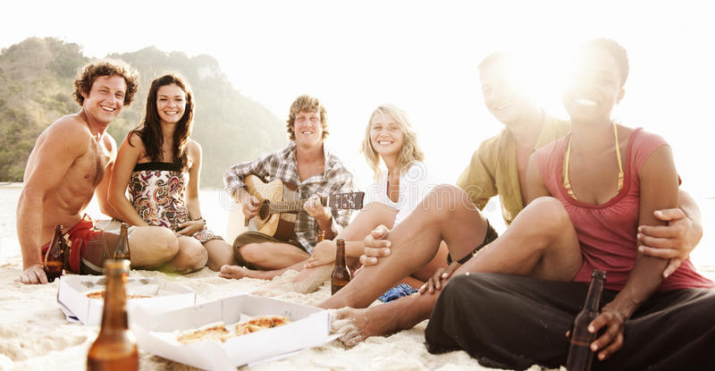 Group of friends having a summer beach party.  royalty free stock photography