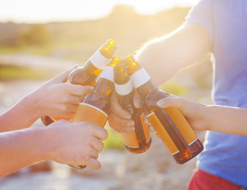 Group of friends having a summer beach party royalty free stock image