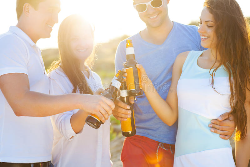Group of friends having a summer beach party royalty free stock photography