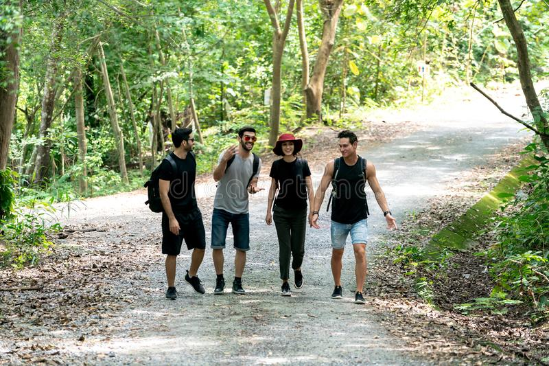 Group Of Friends hiking together through the forest. Travel Hiking and Adventure in forest royalty free stock photography