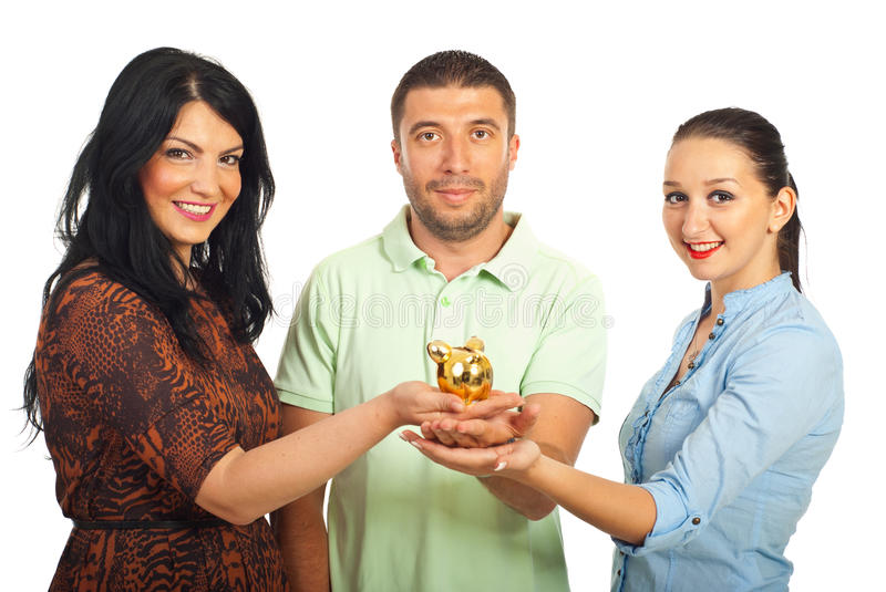 Group of friends holding piggy bank