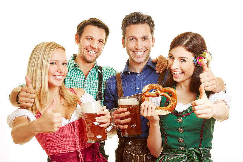 Group of friends holding thumbs up royalty free stock images