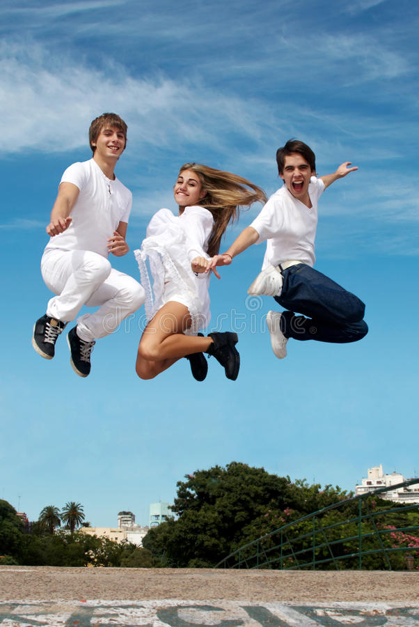 Download Group of friends in a jump stock image. Image of beautiful - 13786087