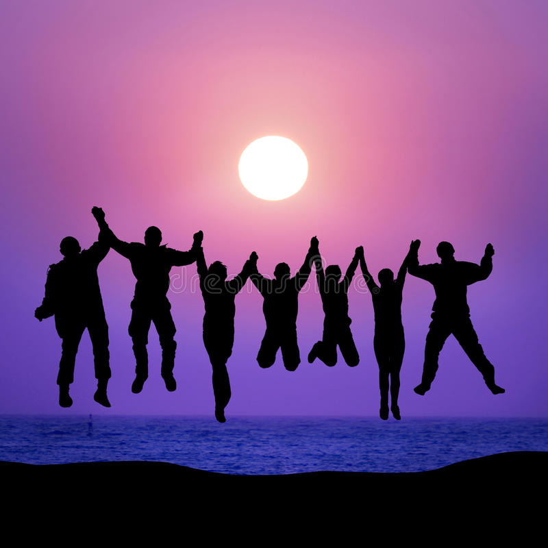 Group of friends jumping against sunset stock photos