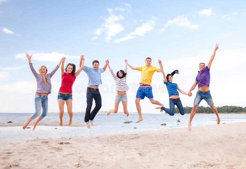 Download Group Of Friends Jumping On The Beach Stock Photo - Image: 34601150