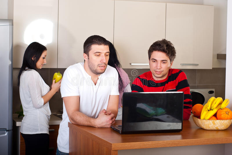Group of friends in a kitchen stock photos