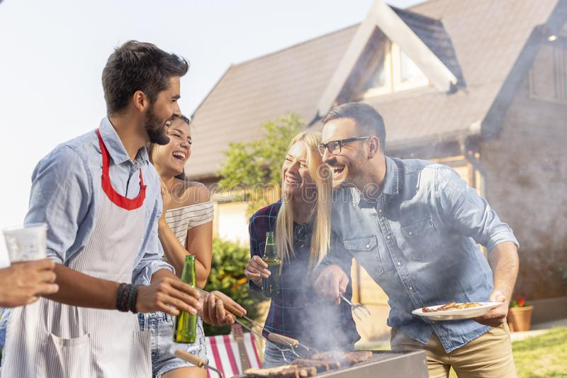 Friends making barbecue royalty free stock photos