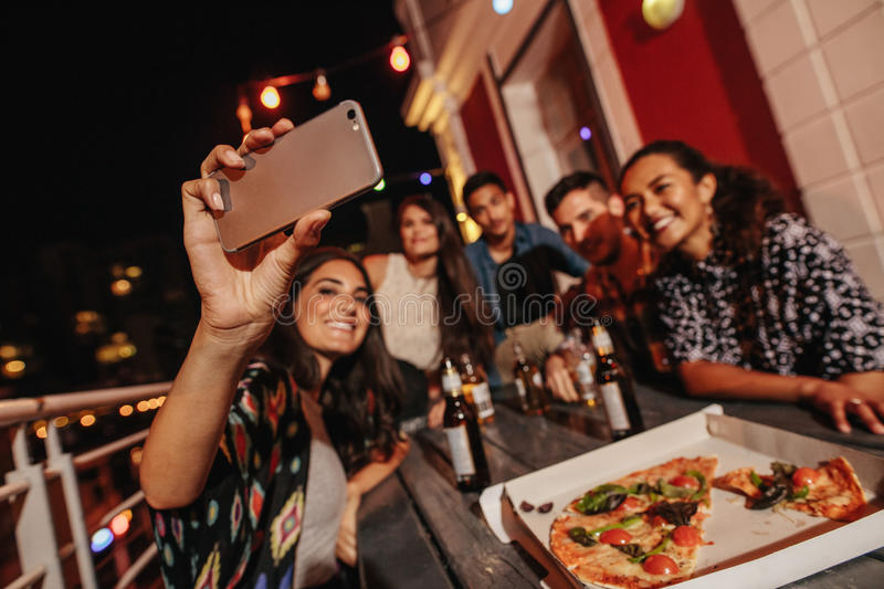 Group of friends making a selfie at rooftop party royalty free stock photo