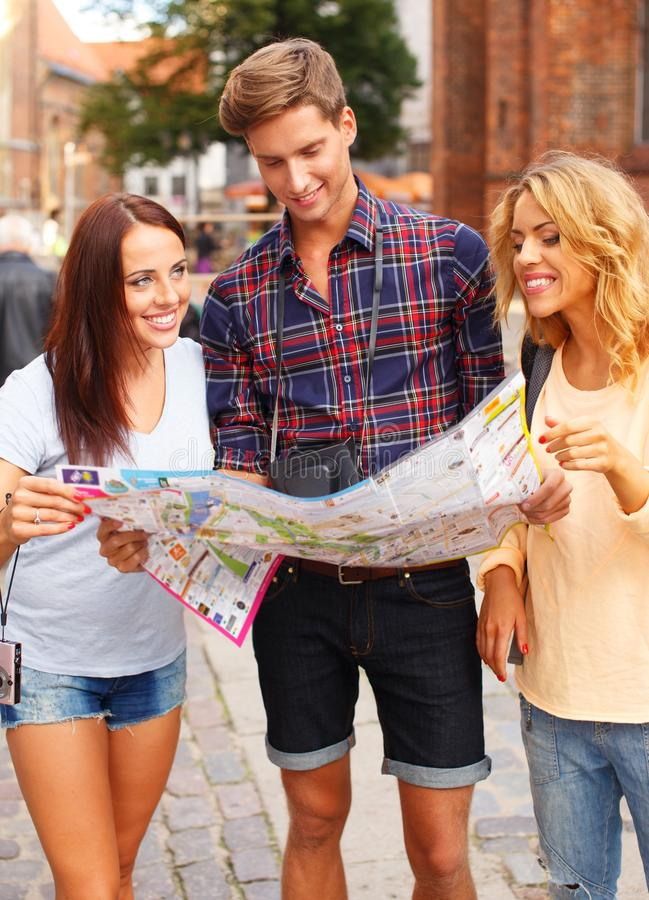 Download Group Of Friends With Map Stock Image - Image: 34645171