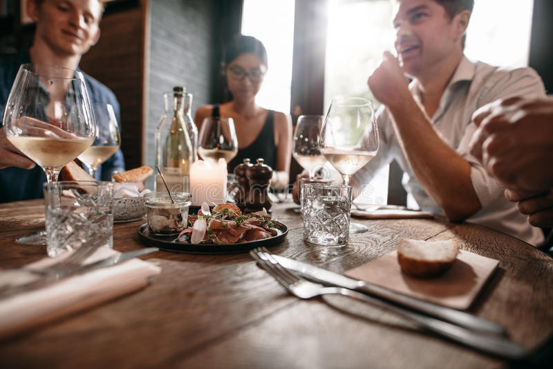 Group of friends meeting at cafe royalty free stock images