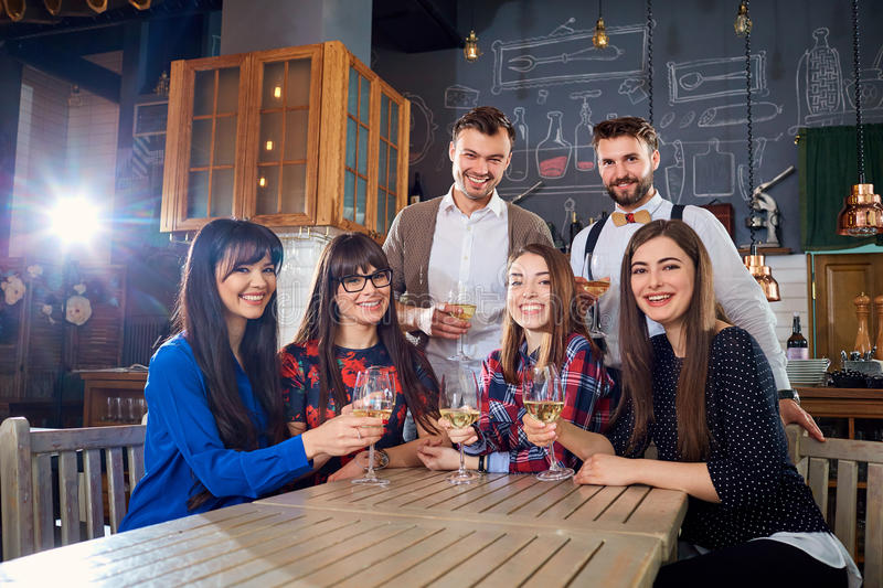 Group of friends at a meeting with glasses laugh and smile stock photography