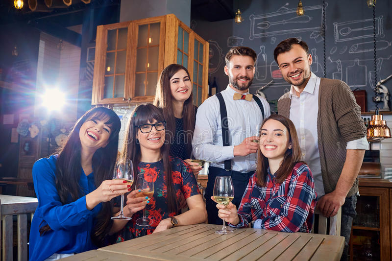 Group of friends at a meeting with glasses laugh and smile royalty free stock photography