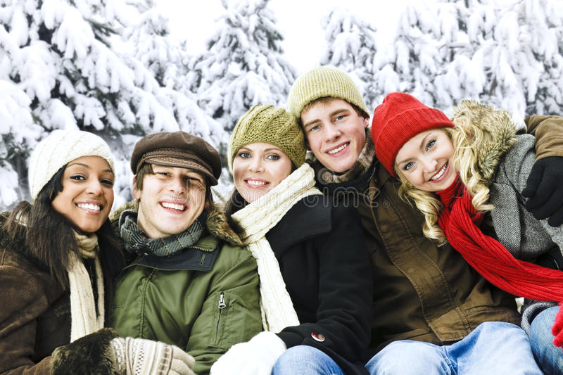Group of friends outside in winter stock photo