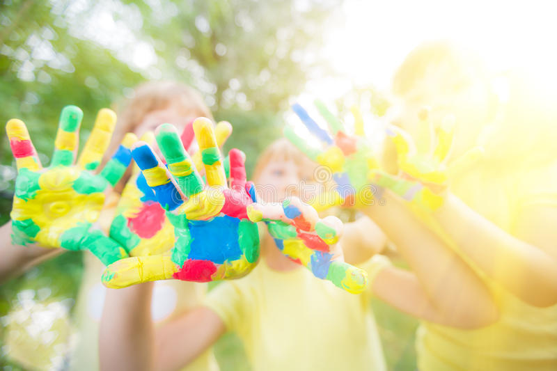 Group of friends with painted hands stock photography