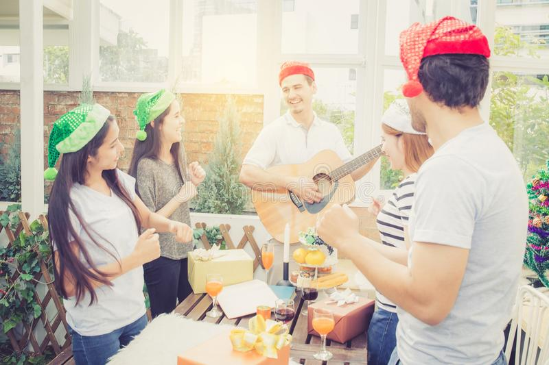 Group of friends party and playing guitar, Surprise birthday stock photography