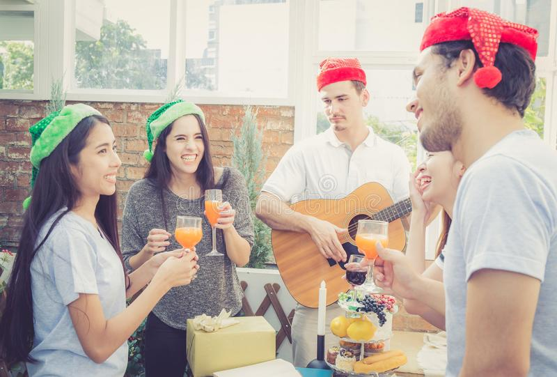 Group of friends party and playing guitar, Surprise birthday, celebrate party christmas and new year royalty free stock photography