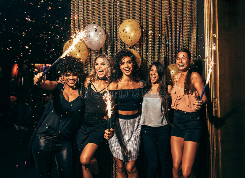 Group of friends partying in nightclub royalty free stock photography
