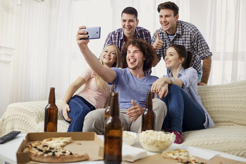 A group of friends are photographed on a camera. stock photos