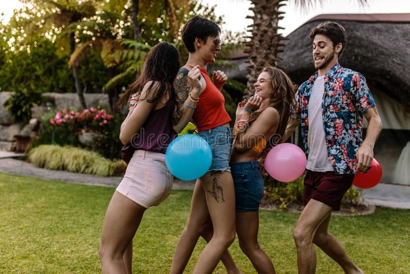 Women popping balloons