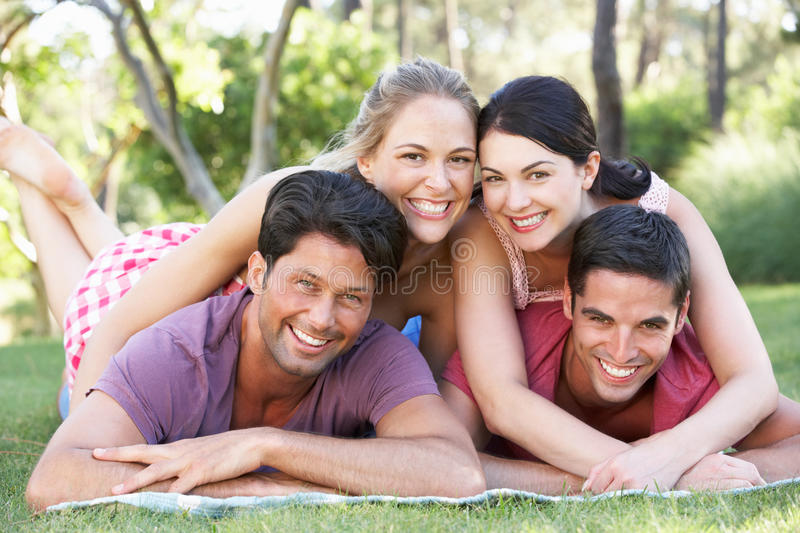 Download Group Of Friends Relaxing In Park Together Stock Image - Image of female, camera: 27274979
