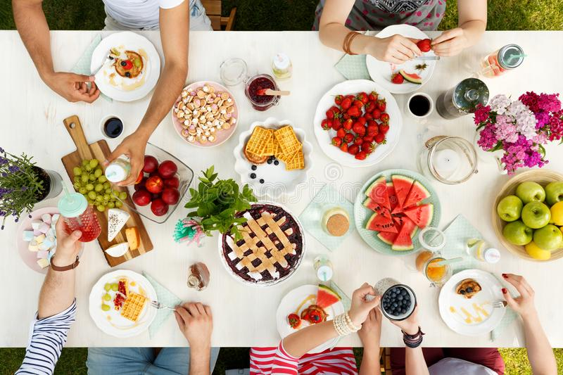 Group of friends sharing meal royalty free stock image