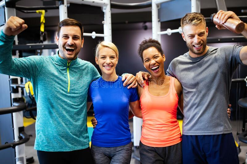 Group of friends smiling and enjoy sport in gym stock photography