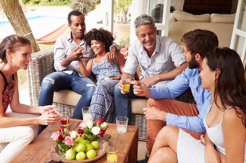 Group of friends socialising in a conservatory stock image
