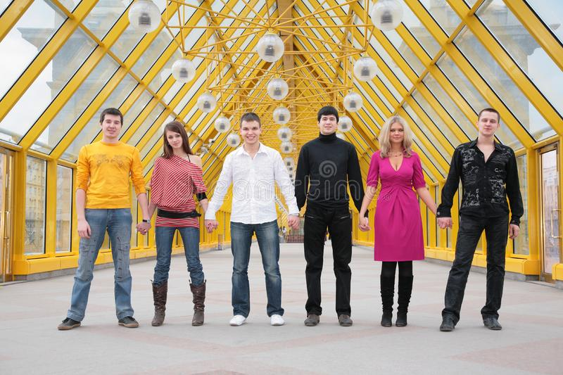 Group of friends it stand taking hands royalty free stock images