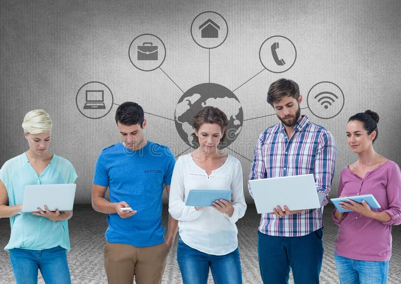 Group of friends standing in front of blank grey background with devices and network world graphics stock photography