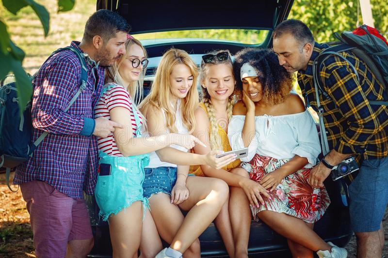 Group of friends standing together and having fun. Young men and women hanging out on their vacation royalty free stock photography