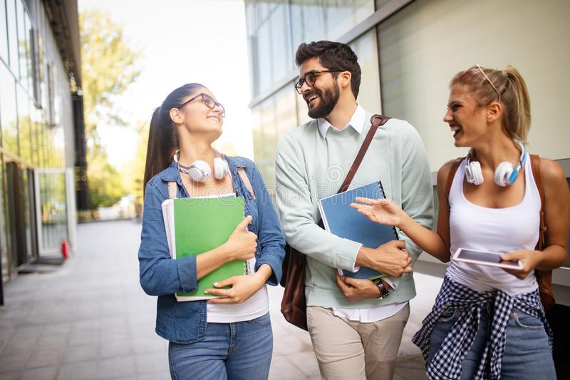 Group of friends studying together at university campus royalty free stock photos