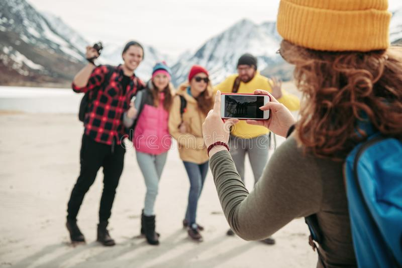 Group of friends taking photo together in mountains royalty free stock images