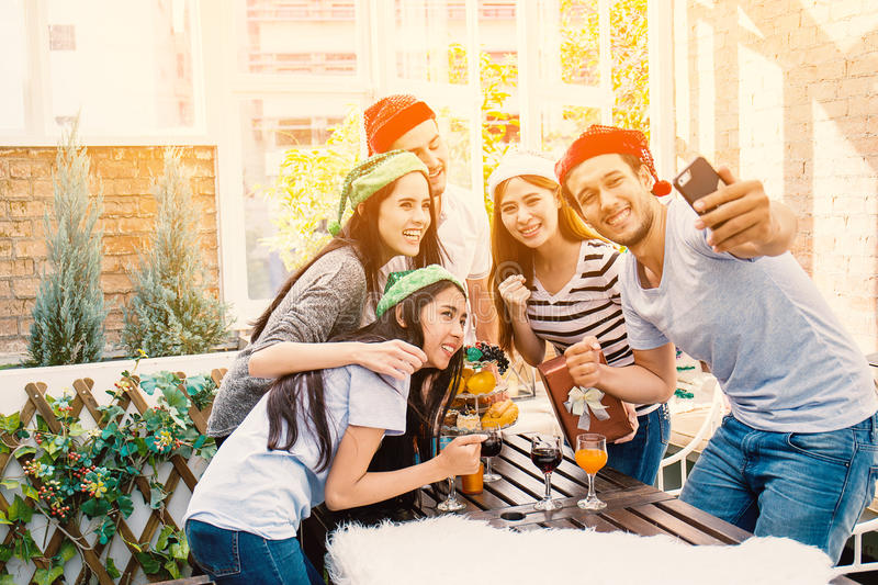 Group of friends taking a photy with smartphone. royalty free stock images
