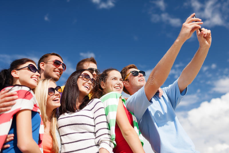 Group Of Friends Taking Picture With Smartphone Stock Image