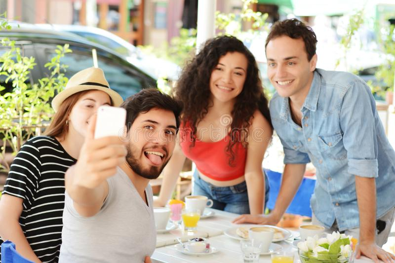 Group of friends taking selfie in cafe royalty free stock photos