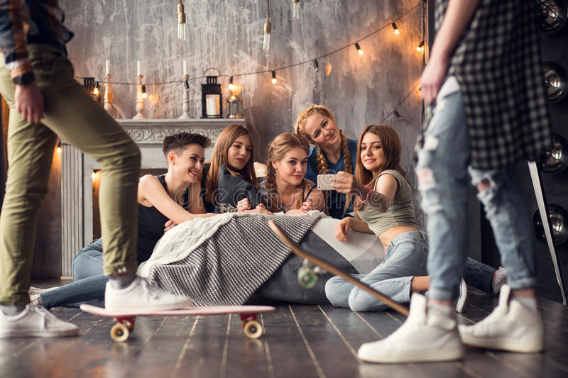 A group of friends are taking selfie friend told others He`s coming to the party tonight. royalty free stock images