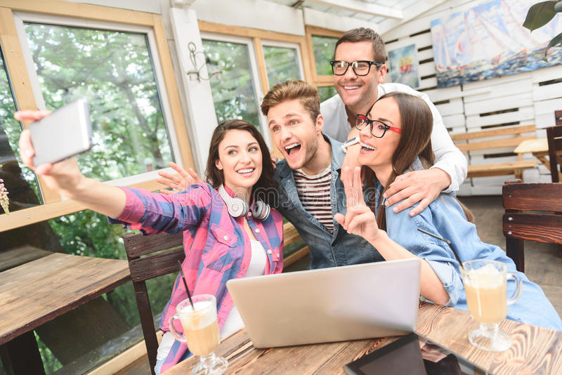 Group of friends taking selfie royalty free stock photography