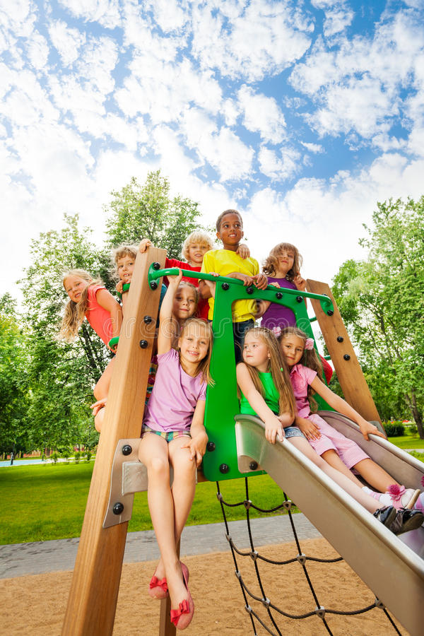 Group of friends together on a chute in summer stock photos