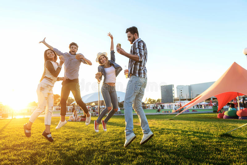 Group of friends together in the park having fun royalty free stock images