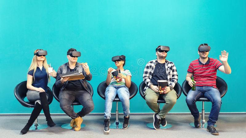 Group of friends using new technology playing on vr glasses indoor royalty free stock photography