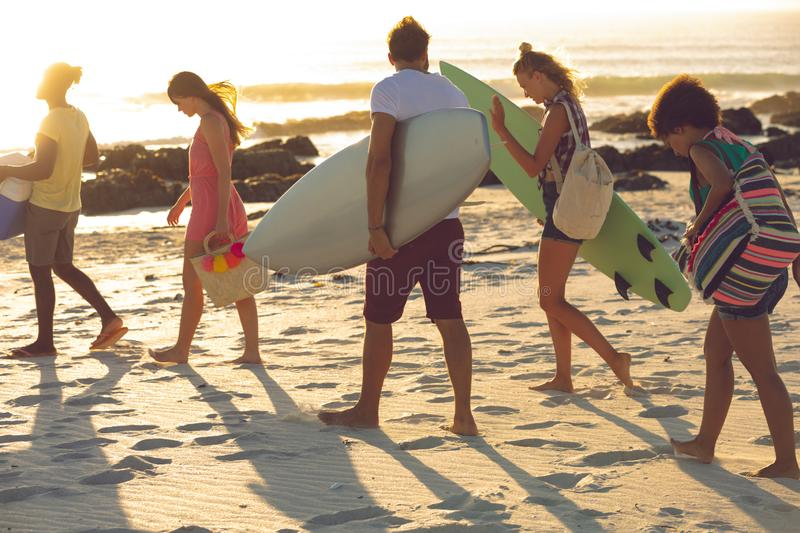 Group of friends walking towards the beach stock photography