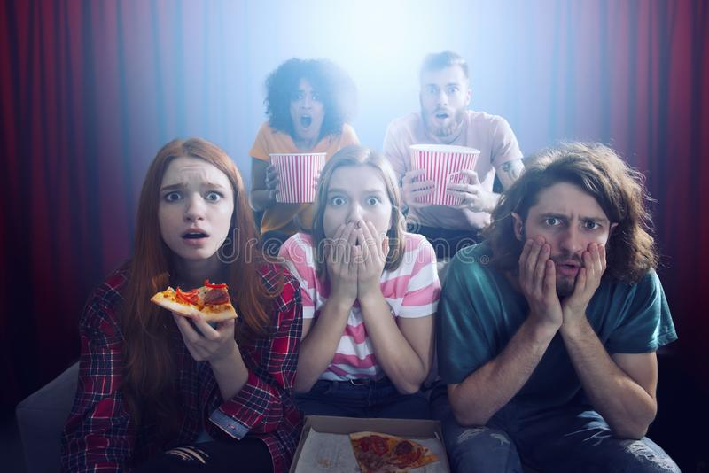 Group of friends watch a film at the cinema stock image