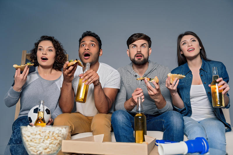 Group of friends watching sport together royalty free stock photography