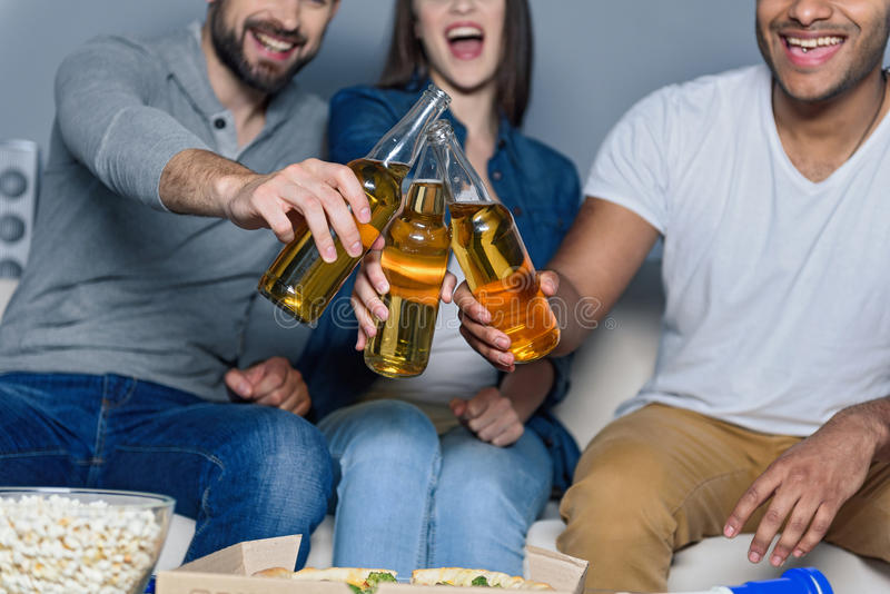 Group of friends watching sport together stock photography
