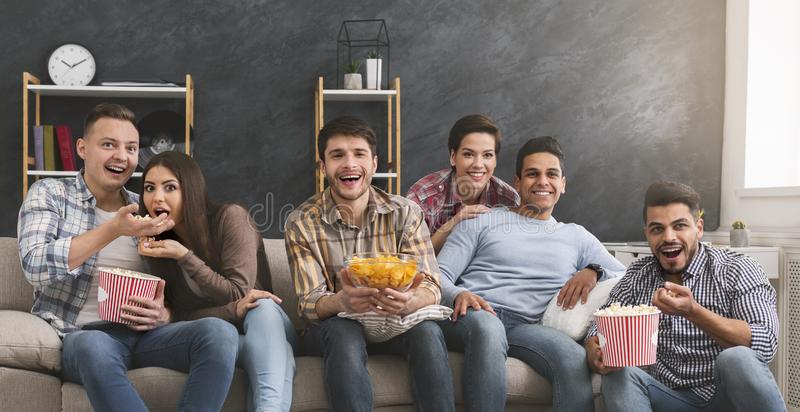 Group of friends watching tv at home royalty free stock photo