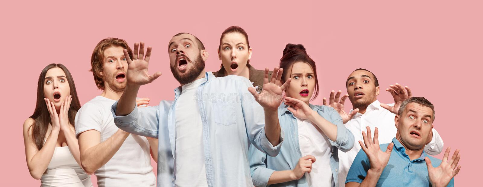 Group of frightened people, woman and man stressful keeping hands on head, terrified in panic, shouting royalty free stock image