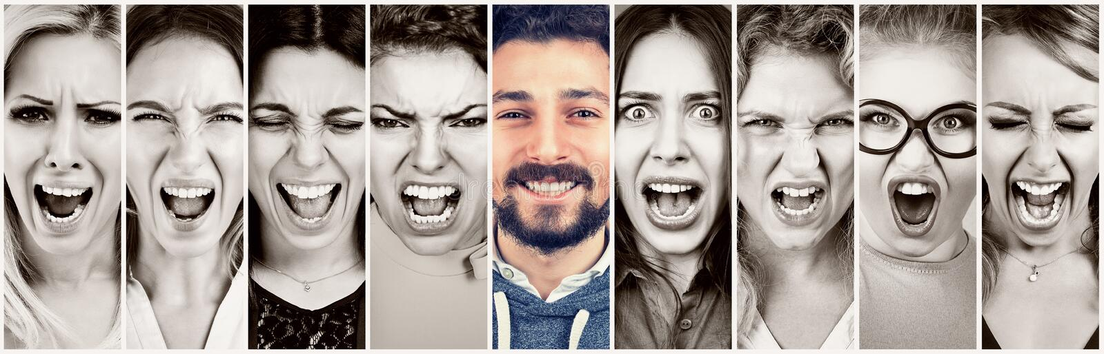 Group of frustrated stressed angry women and a happy smiling beard man stock images