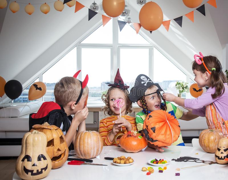 Kids in Halloween party. Group of funny children in costume celebrate together a halloween party stock images