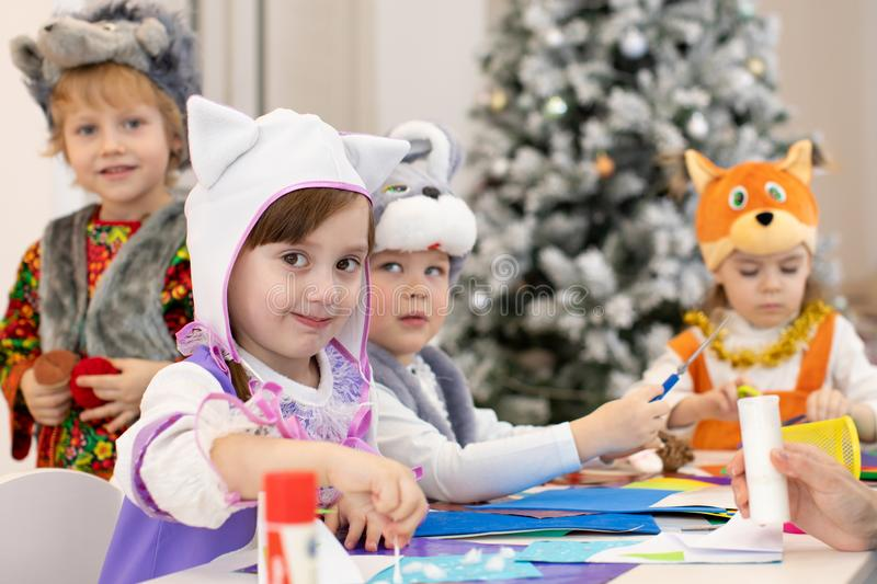 Group of kids prepare to x-mas holiday. Children weared animal costumes stock photo